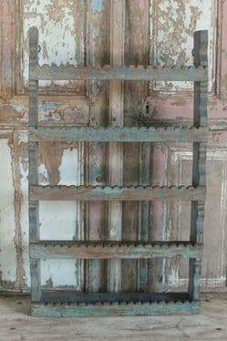 antique wooden wall shelf with faded paint