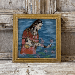 Glass painting of a rajasthani princess and lotus flowers